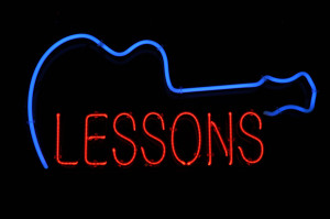 bigstock-Guitar-Lessons-Neon-Sign-7768568