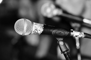 Artistic shot of an SM58 type mic on stage.